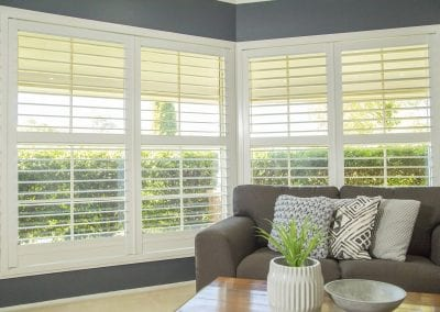 sliding-shutter-newcastle-plantation-shutters-loungeroom-bay-window-open-thornton-pennine-windows-beautiful-blinds-next-wooden-black-iron-fireplace-screen-rustic-custom-brisbane